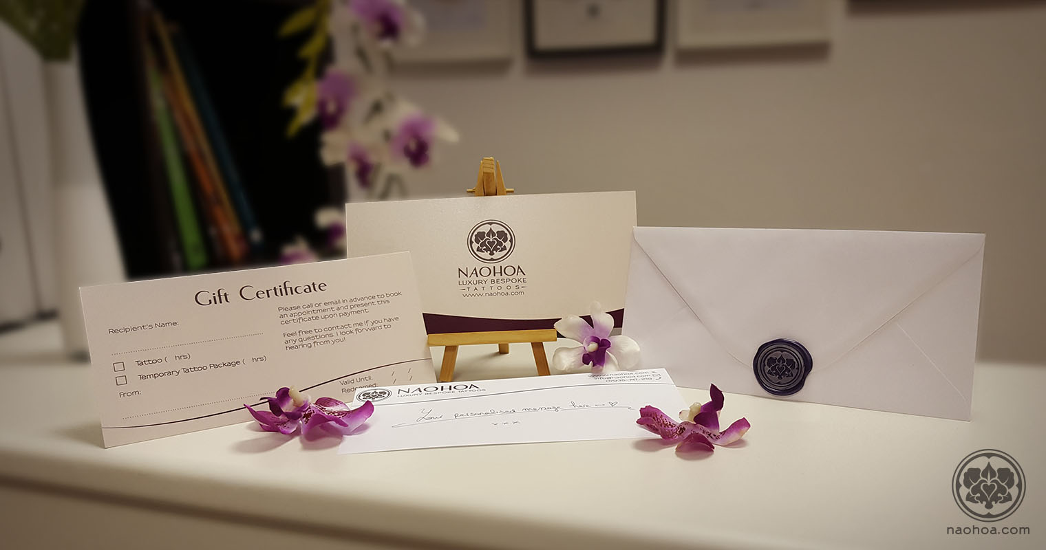 Photograph of Gift Certificates from NAOHOA Luxury Bespoke Tattoos, Cardiff. Founded by Naomi Hoang.