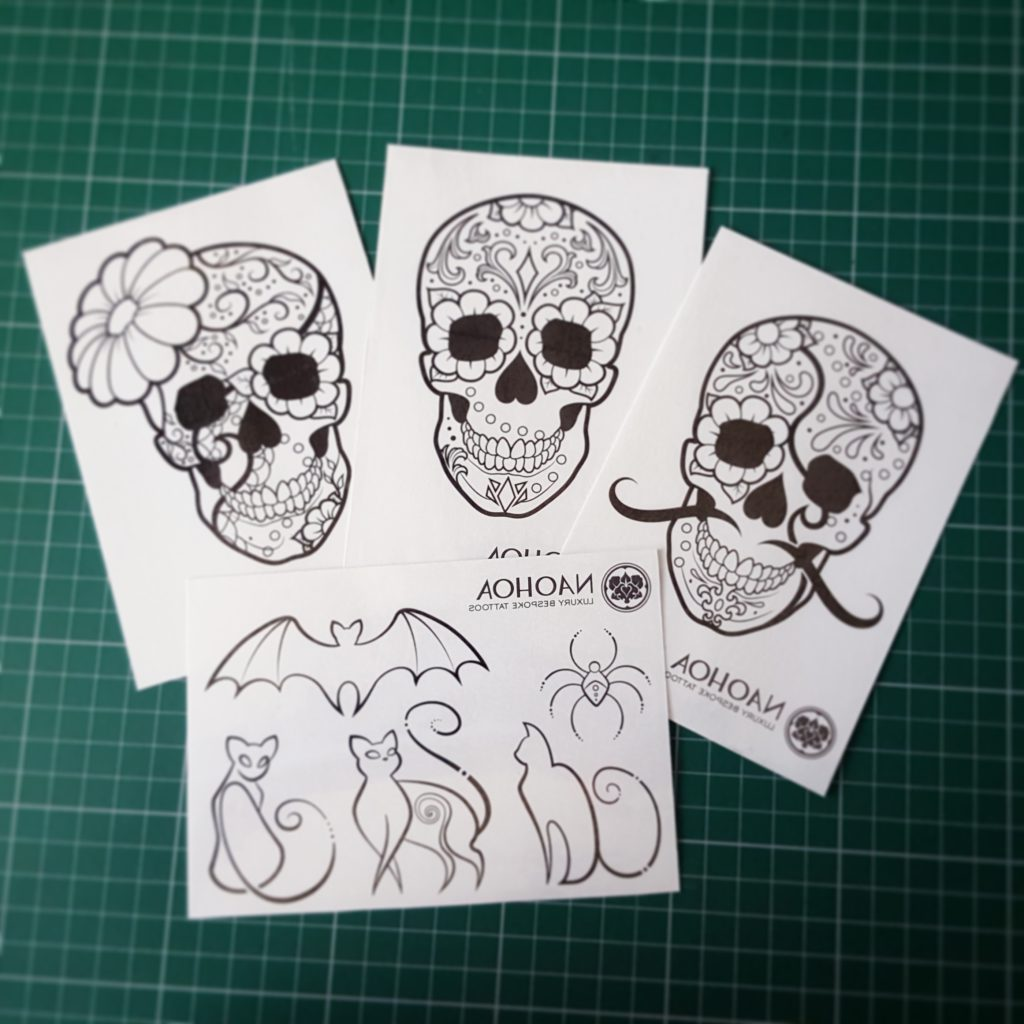 Photo of sugarskull and halloween-themed temporary tattoos designed by Naomi Hoang at NAOHOA Luxury Bespoke Tattoos, Cardiff. Sold to raise money for Mind in support of mental health treatment and awareness.