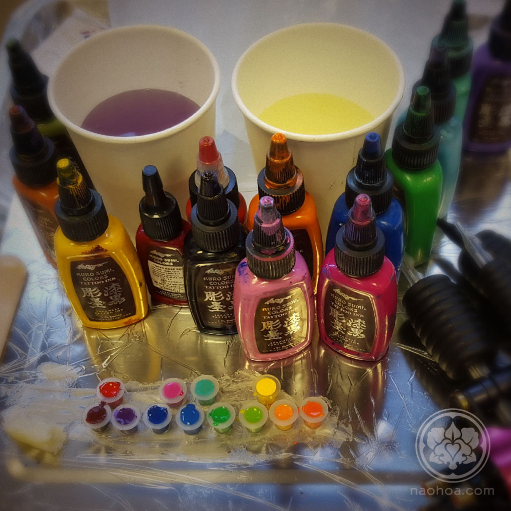 Photo of colourful tattoo inks. Designed and tattooed by female tattoo artist Naomi Hoang at NAOHOA Luxury Bespoke Tattoos, Cardiff (Wales, UK).