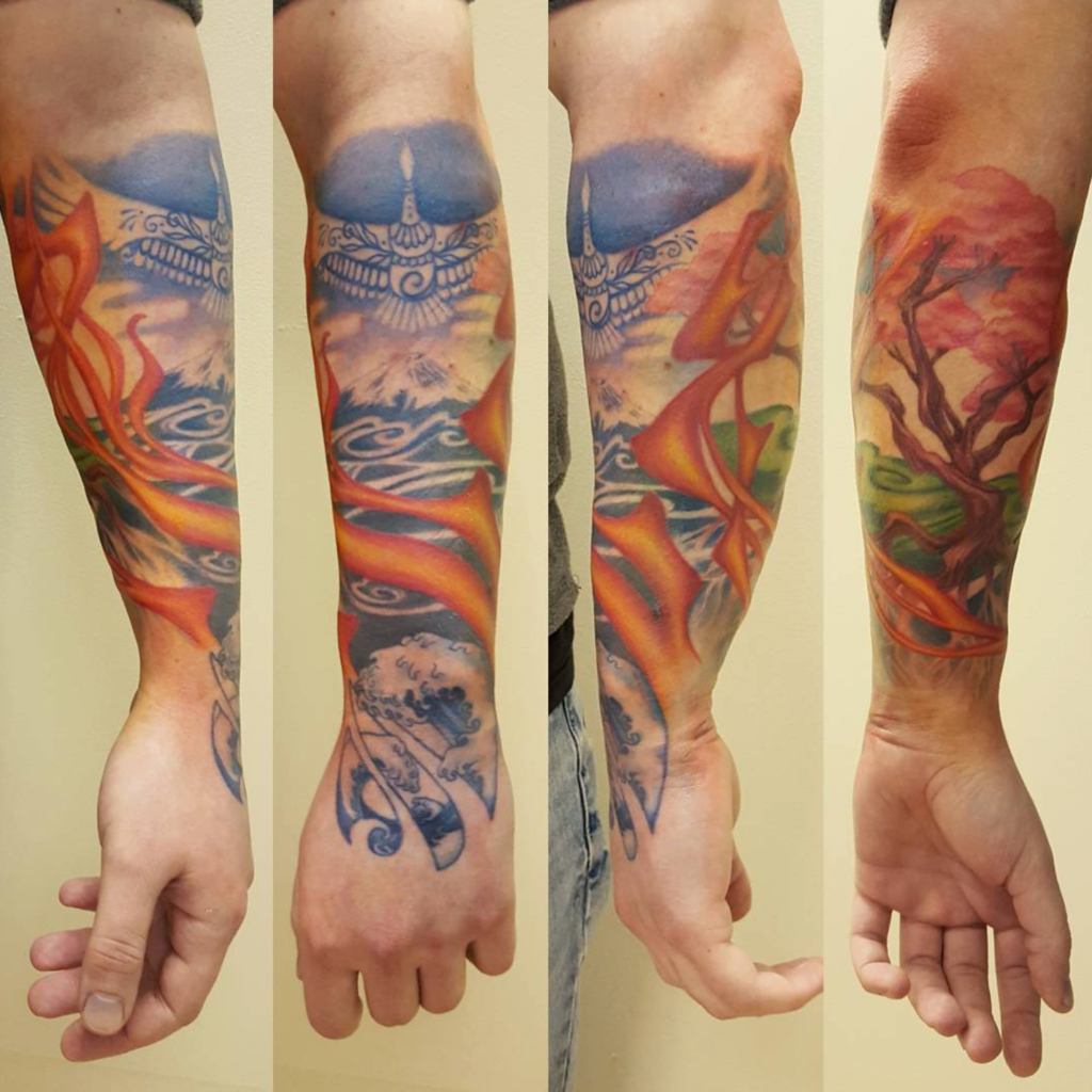 Photo of a Japanese-style sleeve, based on the elements fire, water, earth and sky. Designed and tattooed by Naomi Hoang at NAOHOA Luxury Bespoke Tattoos, Cardiff (Wales, UK).