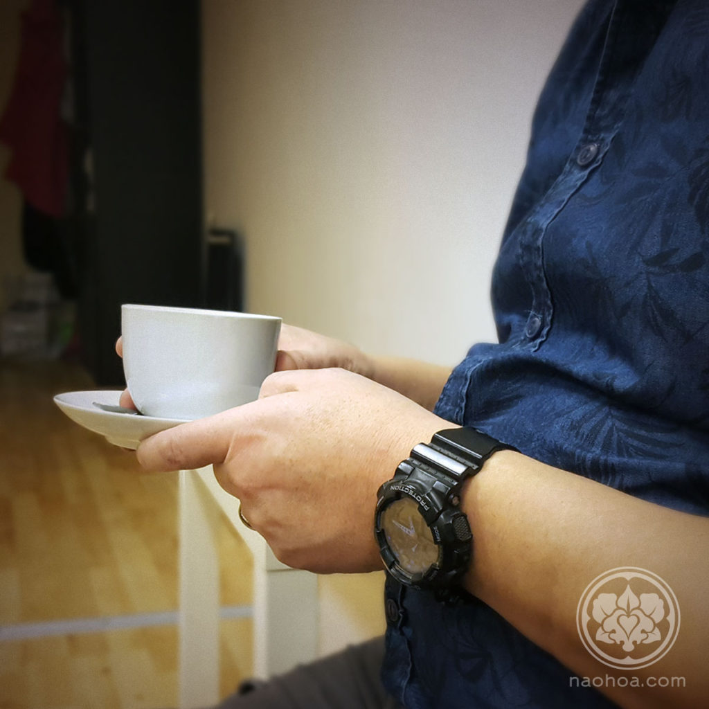 Photo of a client at NAOHOA Luxury Bespoke Tattoos (Cardiff, Wales, UK), drinking Waterloo Tea.