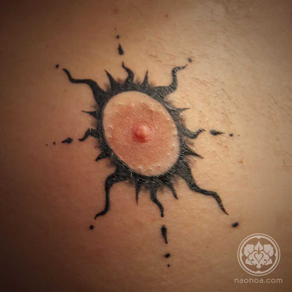 Healed tattoo of a black stylised sun around a nipple. Designed and inked at NAOHOA Luxury Bespoke Tattoos (Cardiff, Wales, UK) by Naomi Hoang.